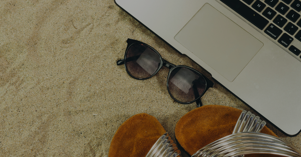 Laptop in sand on vacation